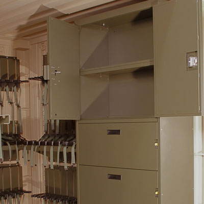 Cabinet storage in tricon for mobilized arms room