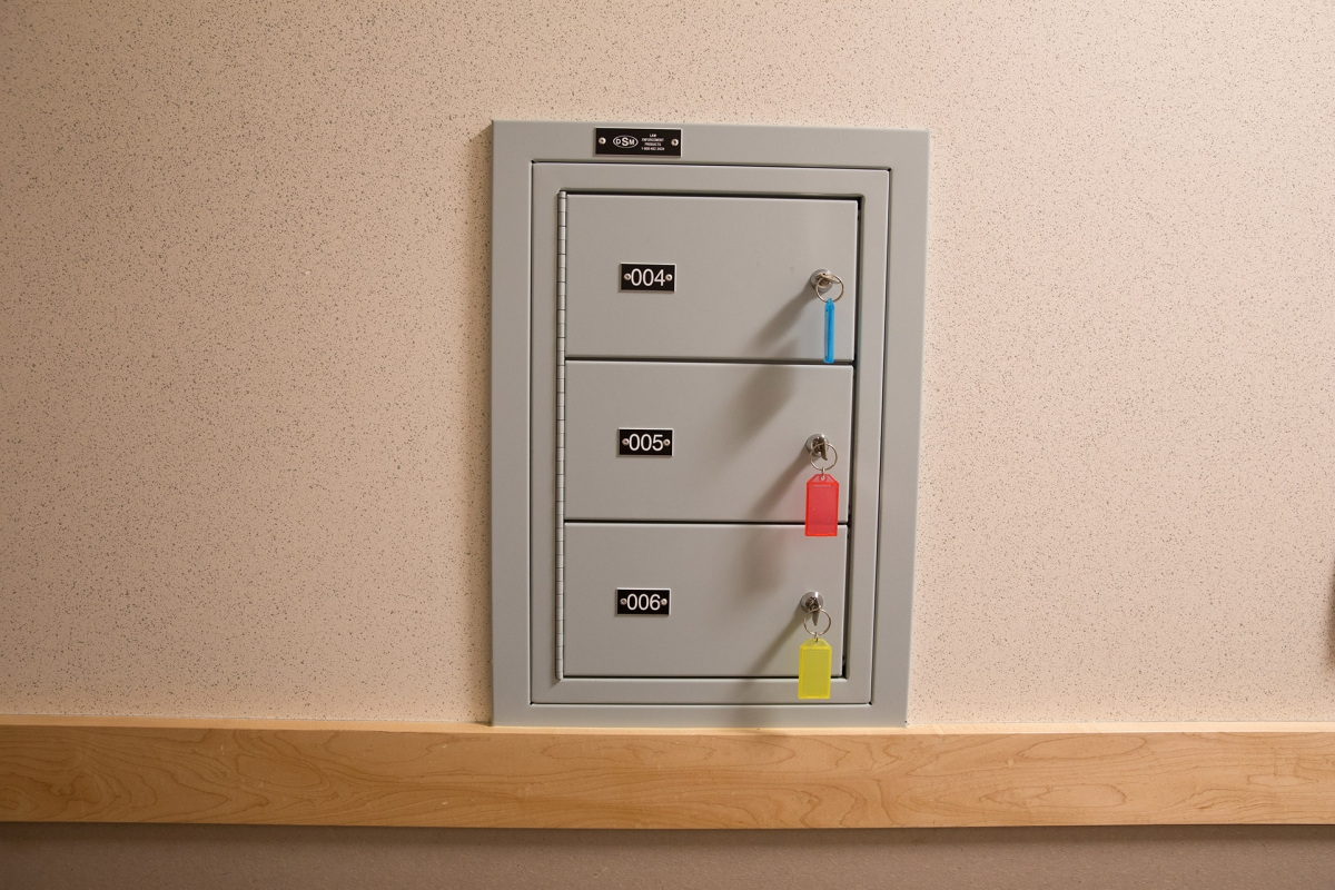 Sally port lockers provide secure handgun storage during suspect processing.