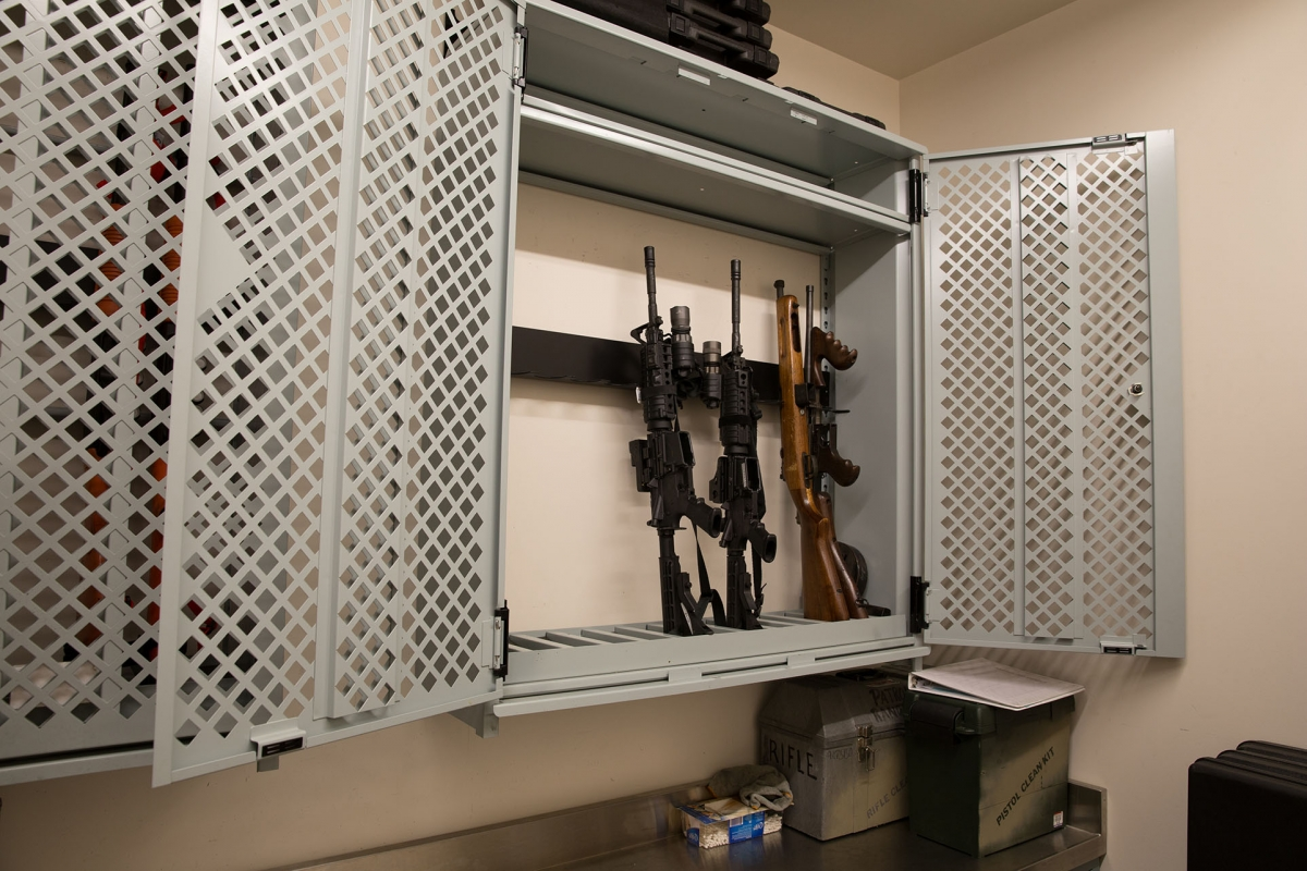 Universal™ Weapons Racks with perforated lockable doors store weapons in the SWAT room.